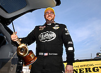 Oct 6, 2013; Mohnton, PA, USA; NHRA top fuel dragster driver Shawn Langdon celebrates after winning the Auto Plus Nationals at Maple Grove Raceway. Mandatory Credit: Mark J. Rebilas-