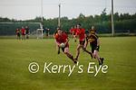 Glenbeigh/Glencar's Caolim Teahan has a look for options as Dr Corkes Mark Egan closes the gap.