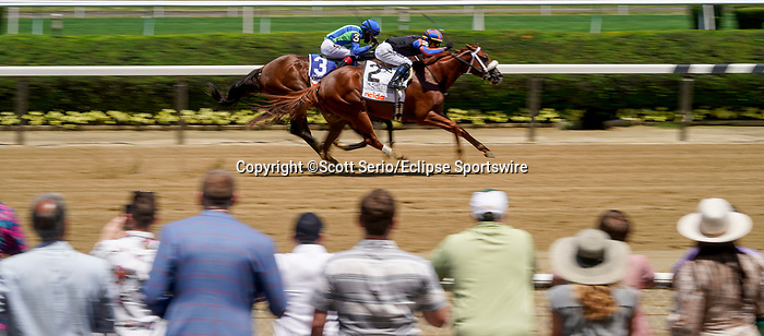 June 5, 2021: Drain the Clock, #2, ridden by jockey Jose Ortiz, wins the Woody Stephens Stakes on Belmont Stakes Day at the Belmont Stakes Festival at Belmont Park in Elmont, New York. Scott Serio/Eclipse Sportswire/CSM