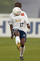 Flo Omagbemi of the San Diego Spirit keeps her eye on the ball during a game against the New York Power. The Spirit defeated the Power 1-0 on July 20th at Mitchel Athletic Complex, Uniondale, NY.