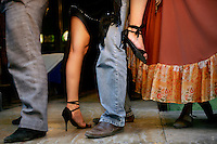 Ceci has her photograph taken with tourists at a restaurant in the El Caminito area of Buenos Aires where she works as a tango dancer.