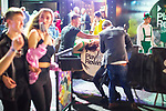 © Joel Goodman - 07973 332324 . 27/12/2017. Wigan, UK. A woman is tended to as she bends over a railing. Revellers in Wigan enjoy Boxing Day drinks and clubbing in Wigan Wallgate . In recent years a tradition has been established in which people go out wearing fancy-dress costumes on Boxing Day night . Photo credit : Joel Goodman