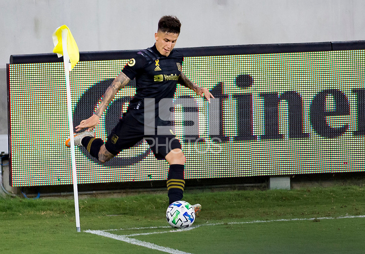 LOS ANGELES, CA - SEPTEMBER 23: Brian Rodriguez #17 of  LAFC takes a corner kick during a game between Vancouver Whitecaps and Los Angeles FC at Banc of California Stadium on September 23, 2020 in Los Angeles, California.