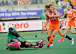 The Hague, Netherlands, June 12: Kim Lammers #23 of The Netherlands celebrates after scoring (4-0) during the second half during the field hockey semi-final match (Women) between The Netherlands and Argentina on June 12, 2014 during the World Cup 2014 at Kyocera Stadium in The Hague, Netherlands. Final score 4-0 (3-0)  (Photo by Dirk Markgraf / www.265-images.com) *** Local caption *** Belen Succi #1 of Argentina, Kim Lammers #23 of The Netherlands