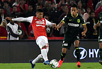 BOGOTA-COLOMBIA, 08-03-2020: Edwin Herrera de Independiente Santa Fe y Sebastian Gomez de Atletico Nacional disputan el balon durante partido entre Independiente Santa Fe y Atletico Nacional de la fecha 8 por la Liga BetPlay DIMAYOR 2020 jugado en el estadio Nemesio Camacho El Campín de la ciudad de Bogota. / Edwin Herrera of Independiente Santa Fe and Sebastian Gomez of Atletico Nacional vie for the ball during a match of the 8th date between Independiente Santa Fe and Atletico Nacional, for the BetPlay DIMAYOR I Leguaje 2020 at the Nemesio Camacho El Campin Stadium in Bogota city. / Photo: VizzorImage / Luis Ramirez / Staff.