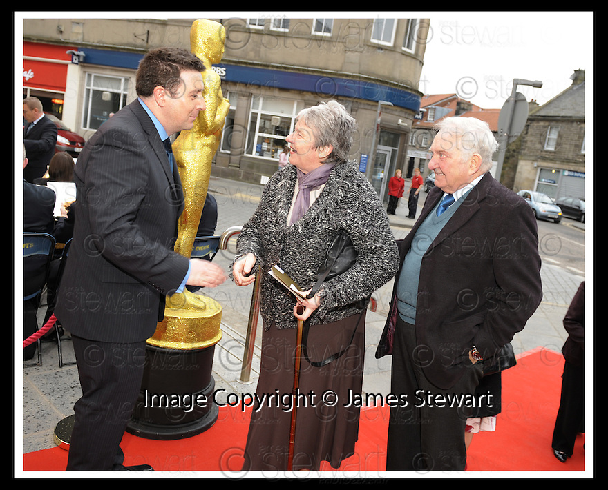 7/04/2009  Copyright Pic: James Stewart.File Name : 05_hippodrome_opening. *** FREE FIRST USE WHEN USED IN ASSOCIATION WITH THE OPENING OF THE BO'NESS HIPPODROME*** COUNCILLOR ADRIAN MAHONEY GREETS THE INVITED GUESTS AS THEY ARRIVE AT THE FIRST NIGHT OFFICIAL RE-OPENING OF THE HIPPODROME IN BO'NESS.....James Stewart Photography 19 Carronlea Drive, Falkirk. FK2 8DN      Vat Reg No. 607 6932 25.Telephone      : +44 (0)1324 570291 .Mobile              : +44 (0)7721 416997.E-mail  :  jim@jspa.co.uk.If you require further information then contact Jim Stewart on any of the numbers above.........