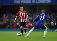 2nd October 2021; Stamford Bridge, Chelsea, London, England; Premier League football Chelsea versus Southampton; James Ward-Prowse of Southampton covered by Timo Werner of Chelsea