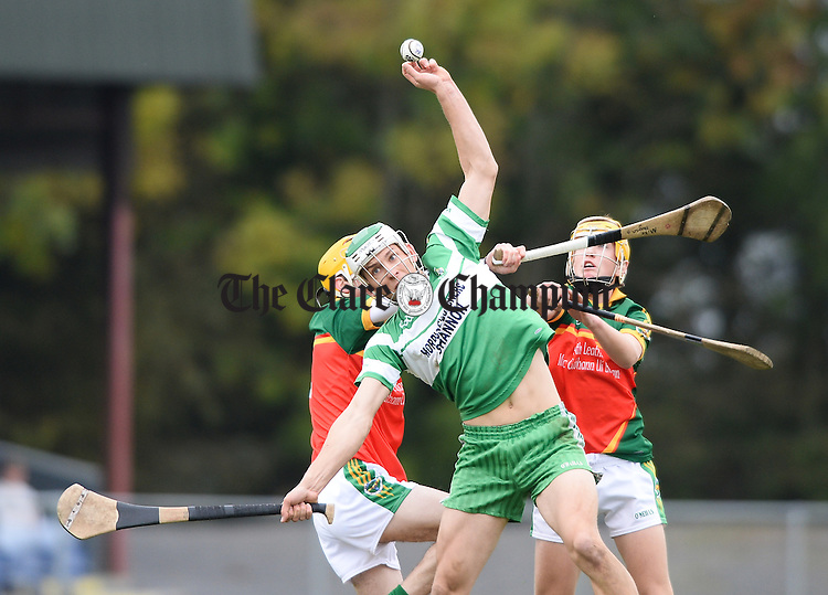 Aaron Shanagher of Wolfe Tones in action against Michael Hogan and Diarmuid O Brien of Broadford during their Minor A county final at Sixmilebridge. Photograph by John Kelly.