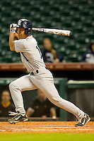 Ford Stainback #11 of the Rice Owls follows through on his swing against the Tennessee Volunteers at Minute Maid Park on March 4, 2012 in Houston, Texas.  The Owls defeated the Volunteers 11-1.  Brian Westerholt / Four Seam Images