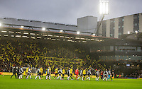 The teams head onto the pitch for the 1st premier league match of 2017 as rain falls during the EPL - Premier League match between Watford and Tottenham Hotspur at Vicarage Road, Watford, England on 1 January 2017. Photo by Andy Rowland.