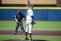 Michigan Wolverines pitcher Jacob Denner (47) looks to his catcher for the sign against the Maryland Terrapins on May 23, 2021 in NCAA baseball action at Ray Fisher Stadium in Ann Arbor, Michigan. Maryland beat the Wolverines 7-3. (Andrew Woolley/Four Seam Images)