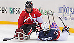 Sochi, RUSSIA - Mar 13 2014 - Adam Dixon picks up the puck as Canada takes on USA in Sledge Hockey Semi-Final at the 2014 Paralympic Winter Games in Sochi, Russia.  (Photo: Matthew Murnaghan/Canadian Paralympic Committee)