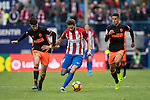 Yannick Ferreira Carrasco of Atletico de Madrid (center) competes for the ball with Carlos Soler of Valencia CF (left) and hist teammate Joao Cancelo (right) during the match Atletico de Madrid vs Valencia CF, a La Liga match at the Estadio Vicente Calderon on 05 March 2017 in Madrid, Spain. Photo by Diego Gonzalez Souto / Power Sport Images