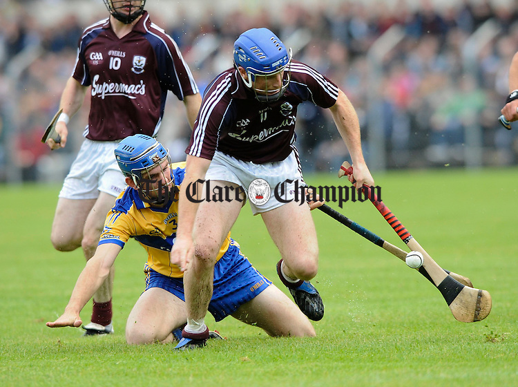 Clare's James Mc Inerney tackles Galway's Cyril Donnellan during their All-Ireland qualifier at Cusack park. Photograph by John Kelly.