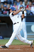 Asheville Tourists second baseman Taylor Featherston #2 swings at a pitch during a game between the Delmarva Shorebirds and the Asheville Tourists at McCormick Field, Asheville, North Carolina April 6, 2012. The Shorebirds won the game 7-2  (Tony Farlow/Four Seam Images)..