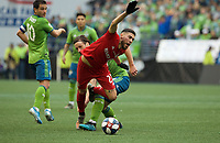 SEATTLE, WA - NOVEMBER 10: Toronto FC midfielder Jonathan Osorio #21 is founded by Seattle Sounders defender Gustav Svensson #4 during a game between Toronto FC and Seattle Sounders FC at CenturyLink Field on November 10, 2019 in Seattle, Washington.