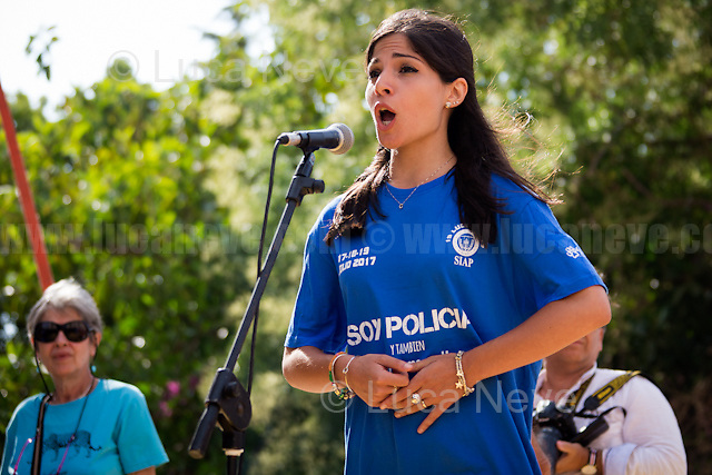 """Singing the Italian Anthem. <br /> <br /> Palermo (Sicily - Italy), 19/07/2017. """"Basta depistaggi e omertà di Stato!"""" (""""Stop disinformation & omertá by the State!"""")(1). Public event to commemorate the 25th Anniversary of the assassination of the anti-mafia Magistrate Paolo Borsellino along with five of his police """"scorta"""" (Escorts from the special branch of the Italian police force who protect Judges): Agostino Catalano, Emanuela Loi (The first Italian female member of the police special branch and the first woman of this branch to be killed on duty), Vincenzo Li Muli, Walter Eddie Cosina and Claudio Traina. The event was held at Via D'Amelio, the road where Borsellino was killed. Family members of mafia victims, amongst others, made speeches about their dramatic experiences, mafia violence and unpunished crimes, State cover-ups, silence ('omertá'), and misinformation. Speakers included, amongst others, Vincenzo Agostino & Augusta Schiera, Salvatore & Cristina Catalano, Graziella Accetta, Massimo Sole, Paola Caccia, Luciano Traina, Angela Manca, Stefano Mormile, Ferdinando Imposimato, Judge Nino Di Matteo. The event ended with the screening of the RAI docu-fiction, 'Adesso Tocca A Me' ('Now it's My Turn' - Watch it here: http://bit.ly/2w3WJUX ).<br /> <br /> For more info & a video of the event please click here: http://bit.ly/2eQfNT3 & http://bit.ly/2eQbmrj & http://19luglio1992.com & http://bit.ly/2he8hCj<br /> <br /> (1) 'Omerta' is the term used in Italy to refer to the code of silence used by mafia organisations, as well as the culture of silence that is entrenched in society at large (especially among victims of mafia crimes, as they fear recriminations), about the existence of organised crime and its activities."""