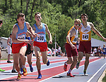 STURGIS, SD: MAY 25:  Josh Schmidt and Same Elliot of Sioux Falls Lincoln and  663 not found and Brady Dannenbring of Sioux Falls Roosevelt in the 4x800 during the 2018 South Dakota State High School Track Meet at Woodle Field in Sturgis, S.D.  (Photo by Dick Carlson/Inertia)