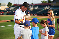 Jupiter Hammerheads Rony Cabrera (7) signs autographs before a game against the Palm Beach Cardinals on August 13, 2016 at Roger Dean Stadium in Jupiter, Florida.  Jupiter defeated Palm Beach 6-2.  (Mike Janes/Four Seam Images)