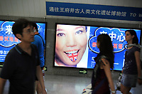 CHINA. Adverisements in Beijing's subway advertise a school using British English. The rise in use of English in China is evident on the streets of Beijing where store-fronts, billboards and clothes all sport English words and phrases. 2009