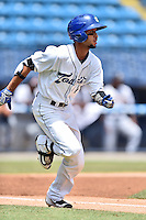 Asheville Tourists shortstop Carlos Herrera (4) runs to first base during a game against the Charleston RiverDogs at McCormick Field on July 10, 2016 in Asheville, North Carolina. The Tourists defeated the RiverDogs 4-2. (Tony Farlow/Four Seam Images)