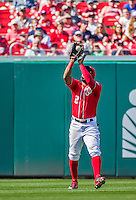 24 May 2015: Washington Nationals outfielder Denard Span pulls in a fly ball during a game against the Philadelphia Phillies at Nationals Park in Washington, DC. The Nationals defeated the Phillies 4-1 to take the rubber game of their 3-game weekend series. Mandatory Credit: Ed Wolfstein Photo *** RAW (NEF) Image File Available ***