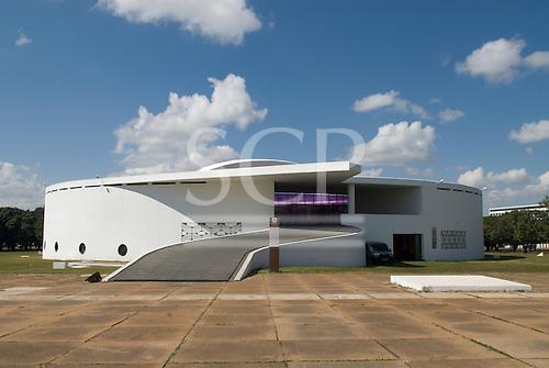 Brasilia, Brazil. The Inidgenous People's Memorial (Memorial dos Povos Indigenas), by Oscar Niemeyer, Praca dos Buritis. The building draws its inspiration from the shape of a traditional Yanomami maloca comunal house.
