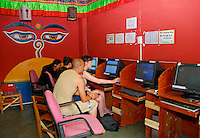 Computer room decorated with Wisdom Eyes of Buddha, at Sim's Cozy Guesthouse, Chengdu, China.  A haven for independent travelers,  a jump-off point for Eastern China and Tibet.