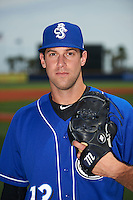 Biloxi Shuckers pitcher Austin Ross (12) poses for a photo before the first game of a double header against the Pensacola Blue Wahoos on April 26, 2015 at Pensacola Bayfront Stadium in Pensacola, Florida.  Biloxi defeated Pensacola 2-1.  (Mike Janes/Four Seam Images)