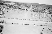 Tohno O'odham Indian Reservation, Arizona<br /> May 5, 2008<br /> <br /> The trails in the dust shows a clear picture of smuggler routes heading north from Mexico into the US. Now a new vehicle barrier has been put in place to stop the traffic through the Tohno O'odham Indian Reservation. Thousands of smuggler trails run through the deserts reroute from Mexico to any major highway in the US.<br /> <br /> Although new roads, fence and vehicle barrier have been put in place along the US/Mexcian border - Arizona illegal traffic is still very heavy in the Tucson sector.