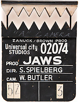 BNPS.co.uk (01202 558833)<br /> Pic: HeritageAuctions/BNPS<br /> <br /> Pictured: The front of the clapperboard.<br /> <br /> A unique shark-teeth clapperboard used during the filming of Jaws has emerged for sale for £30,000. ($40,000)<br /> <br /> The black and white wooden slate, which has 'Jaws' and 'Spielberg' written on it, resembles the fearsome predator with its serrated black and white clap stick.<br /> <br /> It lifts up and down to mimic the great white shark's bite which terrorised Amity island's residents in the 1975 Stephen Spielberg film.