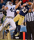 Nov. 23, 2013; Running back Cam McDaniel (33) attempts to make a catch against BYU.<br /> <br /> Photo by Matt Cashore