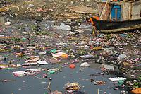 BANGLADESH Dhaka, plastic waste and polluted Buriganga river, boy fetch water / Bangladesch Dhaka , Junge schoepft Wasser aus dem verschmutzten Buriganga Fluss