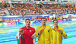 The podium in men's 200m freestyle final, from left, third placed Wales' Calum Jarvis, winner Australia's Thomas Fraser-Holmes, and runner-up, Australia's Cameron McEvoy<br /> <br /> Photographer Chris Vaughan/Sportingwales<br /> <br /> 20th Commonwealth Games - Day 2 - Friday 25th July 2014 - Swimming - Tollcross International Swimming Centre - Glasgow - UK