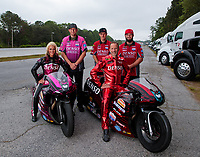 May 3, 2019; Commerce, GA, USA; NHRA pro stock motorcycle rider Angie Smith (left) and husband Matt Smith pose for a portrait with crew members prior to qualifying for the Southern Nationals at Atlanta Dragway. Mandatory Credit: Mark J. Rebilas-USA TODAY Sports