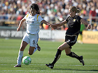 Han Duan (9) sprints down the field, guarded by Leigh Ann Robinson (7). Los Angeles Sol defeated FC Gold Pride 2-0 at Buck Shaw Stadium in Santa Clara, California on May 24, 2009.