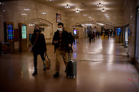 NEW YORK, NEW YORK - FEBRUARY 21: A couple walks in Grand Central Subway Station on February 21, 2021 in New York. A study found that subway air is polluted, exposing the people to high concentrations of hazardous metals and harmful pollutants.  (Photo by John Smith/VIEWpress via Getty Images)