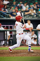 Memphis Redbirds third baseman Patrick Wisdom (5) follows through on a swing during a game against the Round Rock Express on April 28, 2017 at AutoZone Park in Memphis, Tennessee.  Memphis defeated Round Rock 9-1.  (Mike Janes/Four Seam Images)