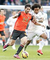 Real Madrid's Marcelo Vieira (r) and Real Sociedad's Esteban Granero during La Liga match.January 31,2015. (ALTERPHOTOS/Acero) /NortePhoto<br /> /NortePhoto.com