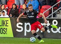WASHINGTON, DC - MARCH 07: Russell Canouse #4 of DC United dribbles up field during a game between Inter Miami CF and D.C. United at Audi Field on March 07, 2020 in Washington, DC.