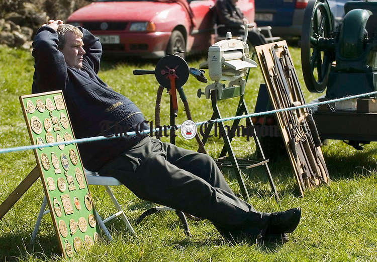 Mike Carey with his antique collection  at the Clare Ploughing Championships in Newmarket on Fergus. Photograph by John Kelly.