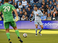 KANSAS CITY, KS - MAY 29: Ilie Sanchez #6 passes the ball back to his goal keeper Tim Melia #29 of Sporting KC during a game between Houston Dynamo and Sporting Kansas City at Children's Mercy Park on May 29, 2021 in Kansas City, Kansas.