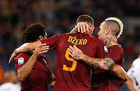 Calcio, Serie A: Roma vs Palermo. Roma, stadio Olimpico, 23 ottobre 2016.<br /> Roma's Edin Dzeko, center, celebrates with teammates Mohamed Salah, left, and Radja Nainggolan, after scoring during the Italian Serie A football match between Roma and Palermo at Rome's Olympic stadium, 23 October 2016. Roma won 4-1.<br /> UPDATE IMAGES PRESS/Riccardo De Luca