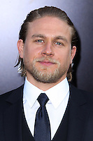 "[(FILE) Actor Charlie Hunnam has been cast as the lead actor in ""Fifty Shades of Grey"" (2014 Film) to play character Christian Grey. Focus Features and Universal Pictures announced Monday, Sept. 2, 2013 that Hunnam will play the 27-year-old billionaire Christian Grey in the big-screen adaptation of E L James' ""Fifty Shades of Grey"". Dakota Johnson will play the college student he captivates, Anastasia Steele.] HOLLYWOOD, CA - JULY 09: Actor Charlie Hunnam attends the premiere of Warner Bros. Pictures and Legendary Pictures' 'Pacific Rim' at the Dolby Theatre on July 9, 2013 in Hollywood, California. (Photo by Xavier Collin/Celebrity Monitor)"