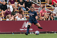 NEWTON, MA - AUGUST 29: Kara Long #15 of University of Connecticut passes the ball during a game between University of Connecticut and Boston College at Newton Campus Soccer Field on August 29, 2021 in Newton, Massachusetts.