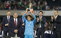 CHICAGO, ILLINOIS - JULY 07: Guillermo Ochoa #13 receives his Golden Glove award during the 2019 CONCACAF Gold Cup Final match between the United States and Mexico at Soldier Field on July 07, 2019 in Chicago, Illinois.