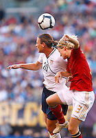 22 MAY 2010:  USA's Abby Wambach #20 and Germany's Saskia Bartusiak #3 during the International Friendly soccer match between Germany WNT vs USA WNT at Cleveland Browns Stadium in Cleveland, Ohio. USA defeated Germany 4-0 on May 22, 2010.