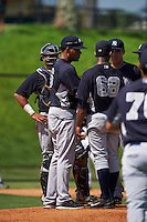 GCL Yankees 1 pitching coach Elvys Quezada (sunglasses) talks with pitcher Anderson Severino (68) as catcher Jerry Seitz (78) and Donny Sands (89) listen in during the first game of a doubleheader against the GCL Tigers on August 5, 2015 at Tigertown in Lakeland, Florida.  GCL Tigers derated the GCL Yankees 5-2.  (Mike Janes/Four Seam Images)