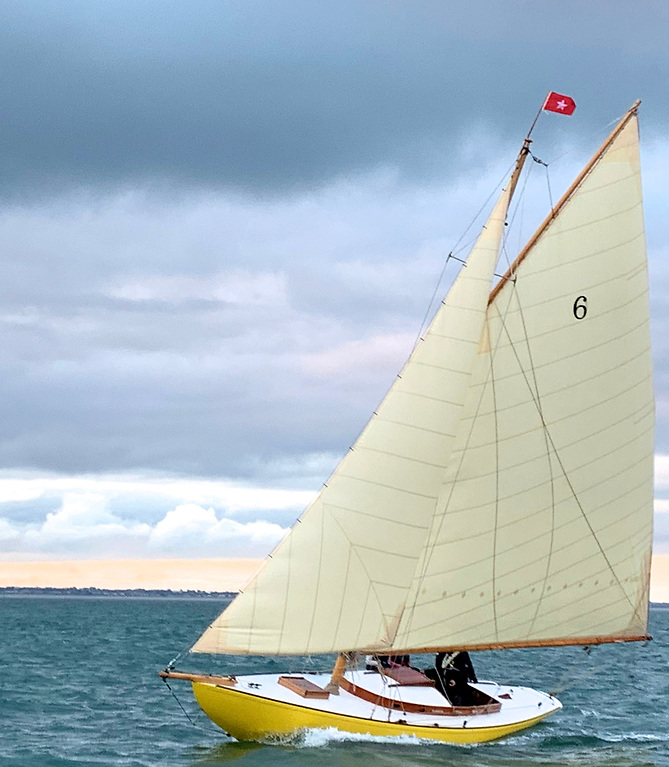 The restored DB21 Naneen of 1905, the only boat of the class actually built in Dun Laoghaire, is flying the house flag of her first owner, Cosby Burrows (1856-1925) of County Cavan. Photo: Gilly Goodbody