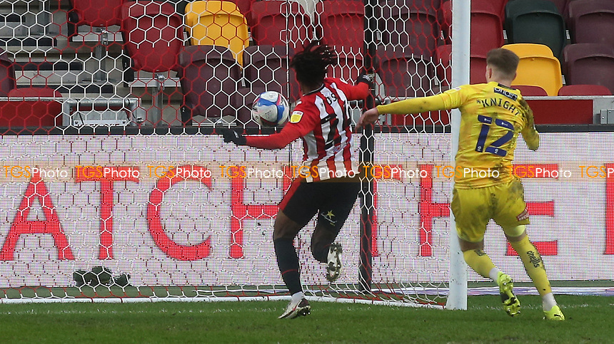 Tariqe Fosu races after the ball to ensure it crosses the line for Brentford's second goal during Brentford vs Wycombe Wanderers, Sky Bet EFL Championship Football at the Brentford Community Stadium on 30th January 2021